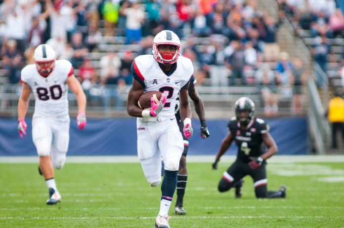 Wide receiver Tyraiq Beals runs in for a score during UConn's 20-9 win over Cincinnati on Oct. 8, 2016. Jackson Haigis/The Daily Campus