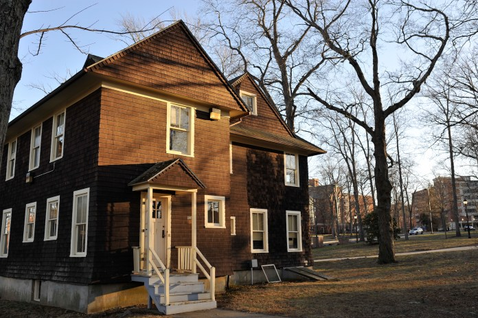 """Abandoned fraternity houses near south campus. The houses are acting as """"contributing resources"""" to the UConn Historic District.(Jason Jiang/The Daily Campus)"""