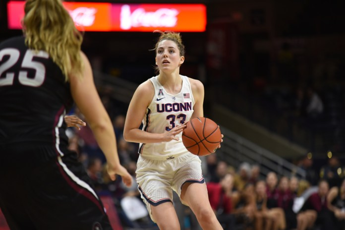 Sophomore forward Katie Lou Samuelson surveys the court during the Huskies 111-39 victory over the Indiana University of Pennsylvania Crimson Hawks in the team's exhibition opener at Gampel Pavilion. Samuelson let the team in baskets and scored 24 points. (Charlotte Lao/The Daily Campus)