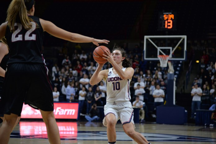 Freshman Molly Bent (10) lines up a shot during the Huskies 111-39 victory over the Indiana University of Pennsylvania Crimson Hawks in the team's exhibition opener at Gampel Pavilion. Bent scored 2 points in her first career game. (Amar Batra/The Daily Campus)