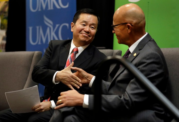 Mun Y.Choi, left, shakes hands with University of Missouri interim president Mike Middleton during an event naming Choi as the new president of the four-campus system Wednesday, Nov. 2, 2016, in Jefferson City, Mo.Choi, who has been provost at the University of Connecticut since 2012, takes over the job nearly a year after the Columbia campus was roiled by protests over administrators' handling of racial and other issues at the university. (Jeff Roberson/AP)