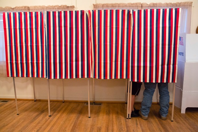In this Nov. 8, 2016, photo, a voter fills out his ballot at the Wilson School House in unincorporated Wilson, Idaho. Donald Trump's victory came as a surprise to many Americans, the nation's pollsters most of all. (Otto Kitsinger/AP)