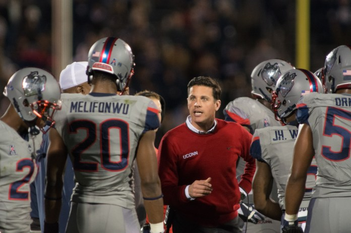 UConn football head coach Bob Diaco talks to Obi Melifonwu (20) and the rest of the defense during the Huskies's loss to Temple on Nov. 4, 2016. (Jackson Haigis/The Daily Campus)