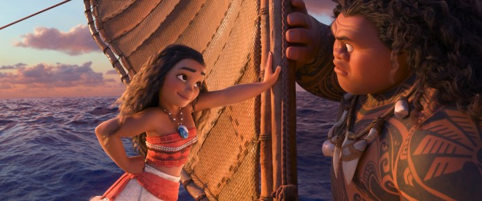 """This image released by Disney shows characters Maui, voiced by Dwayne Johnson, right, and  Moana , voiced by Auli'i Cravalho, in a scene from the animated film, """" Moana ."""" (Disney via AP)"""