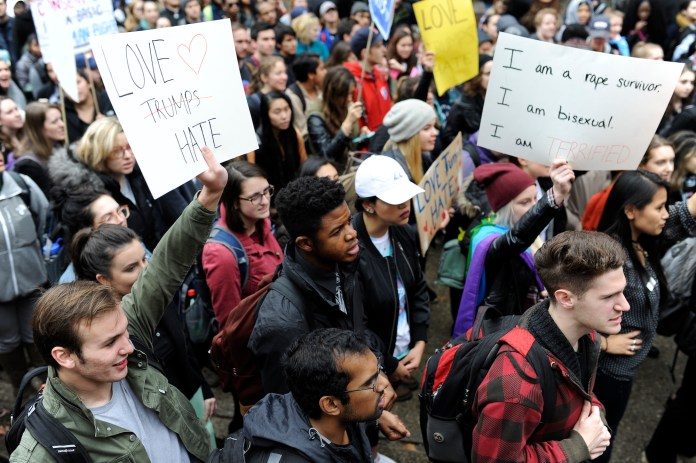 Students at the Nov. 9 Rally for the People stand together against hate.UConn students rally against Trump to show UConn as a community will denounce the racism, xenophobia, and sexism. (Jason Jiang/The Daily Campus)