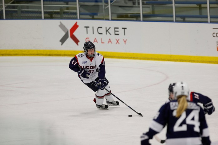 Sophomore defender Jaime Fox handles the puck in a game vs. Penn State on October 21st. (Tyler Benton/The Daily Campus)