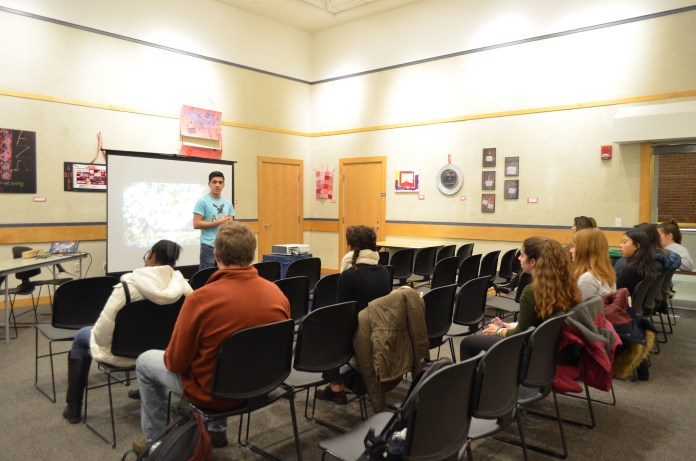 """Students attended a film screening and post-film discussion of """"Wilhelmina's War"""" in the Student Union Art Gallery on Monday, December 5. The film screening was held in honor of World AIDS Day. (Akshara Thejaswi/The Daily Campus)"""