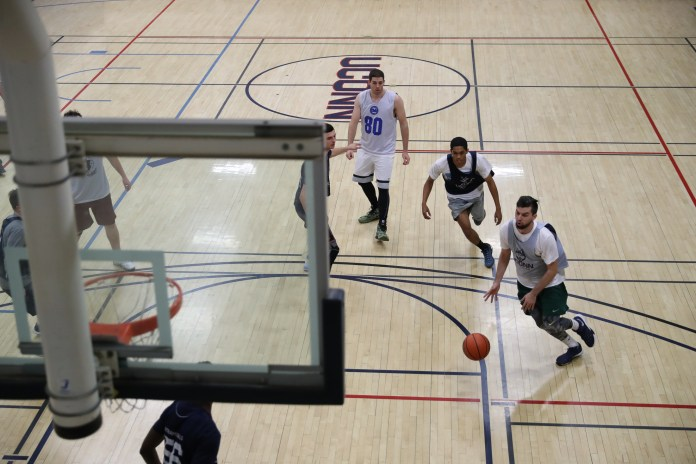 Students play basketball in the Student Recreation Center on December 7, 2016. The UConn Board of Trustees has authorized the start of bidding for the new rec center that will open in 2019. (Owen Bonaventura/The Daily Campus)
