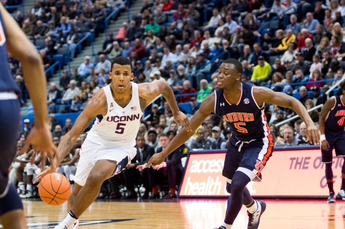 Vance Jackson runs forward with the ball during a 70-67 overtime loss to Auburn on Friday, Dec. 23 at the XL Center in Hartford. Jackson went 1-9 from the field and 1-8 from 3-point range, but notched nine rebounds. (Jackson Haigis/The Daily Campus)