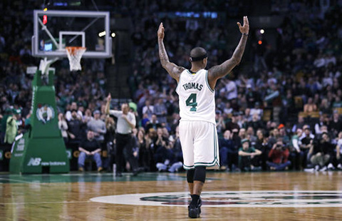Boston Celtics guard Isaiah Thomas (4) raises his arms as he celebrates after hitting a 3-pointer against the Charlotte Hornets during the second half of an NBA basketball game in Boston, Monday, Jan. 16, 2017.Thomas had 35 points as the Celtics defeated the Hornets 108-98. (Charles Krupa/AP)