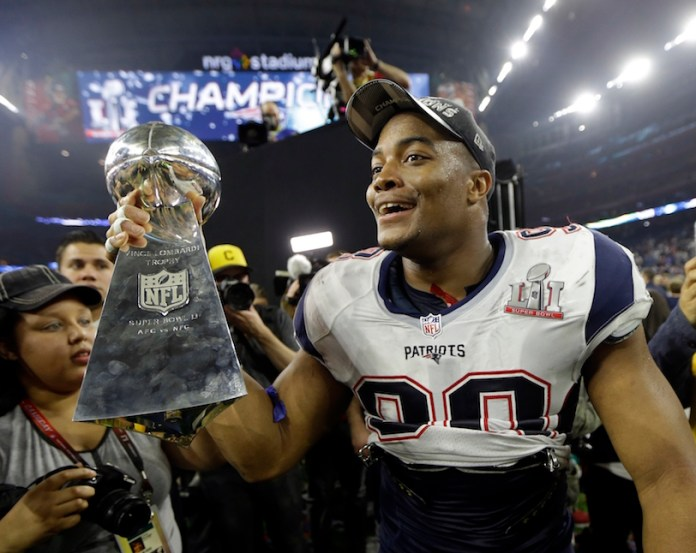 New England Patriots' Trey Flowers celebrates with the Vince Lombardi Trophy after defeating the Atlanta Falcons in the NFL Super Bowl 51 football game Sunday, Feb. 5, 2017, in Houston. The Patriots defeated the Falcons 34-28. (AP Photo/Mark Humphrey)