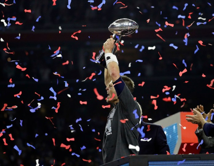 New England Patriots'Tom Brady hoists the Vince Lombardi Trophy after the NFL Super Bowl 51 football game against the Atlanta Falcons Sunday, Feb. 5, 2017, in Houston. The New England Patriots won 34-28. (AP Photo/Eric Gay)