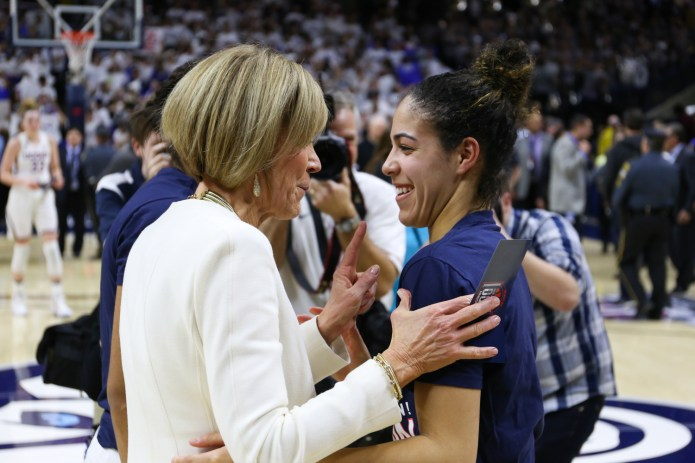 Kia Nurse (right) and Chris Dailey share a laugh after the game.(Jackson Haigis/The Daily Campus)