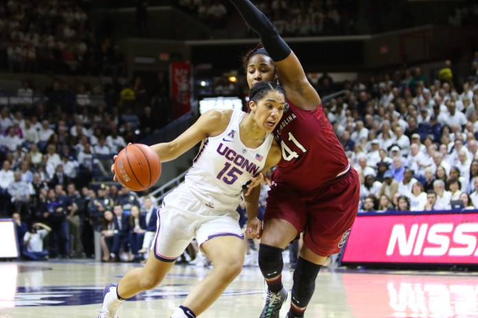 Gabby Williams drives to the basket against South Carolina's Alaina Coates. Williams led the Huskies with 26 points and 14 rebounds.(Jackson Haigis/The Daily Campus)