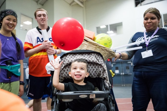 Students gather in the Greer Field House to participate in the annual 18 hour dance marathon HuskyTHON to raise money for Connecticut Children's Medical Center from Saturday, Feb. 18 to Sunday, Feb. 19, 2017. (Owen Bonaventura/The Daily Campus)