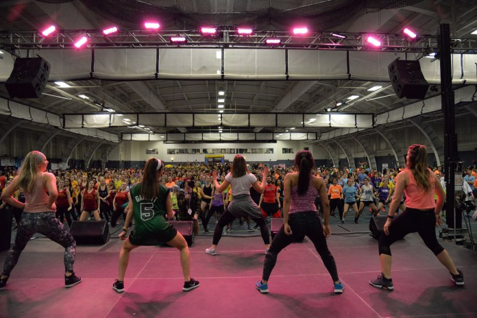 HuskyTHON participants take a break from dancing by participating in a zumba session during the early morning hours of HuskyTHON 2017 in the Greer Field House on Sunday, Feb. 19, 2017. (Amar Batra/The Daily Campus)