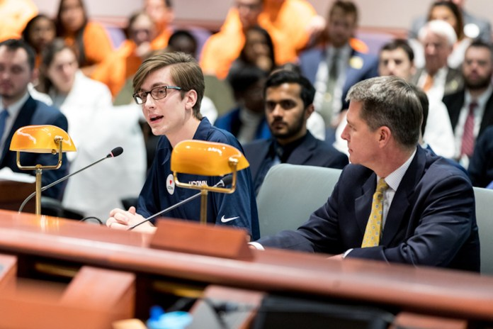 USG President Daniel Byrd testifies alongside David Olchowski. Students from the UConn Undergraduate Student Government go to the Connecticut State Capitol Building in Hartford, CT to testify against potential UConn budget cuts on Wednesday, Feb. 15, 2017. (Owen Bonaventure/The Daily Campus)