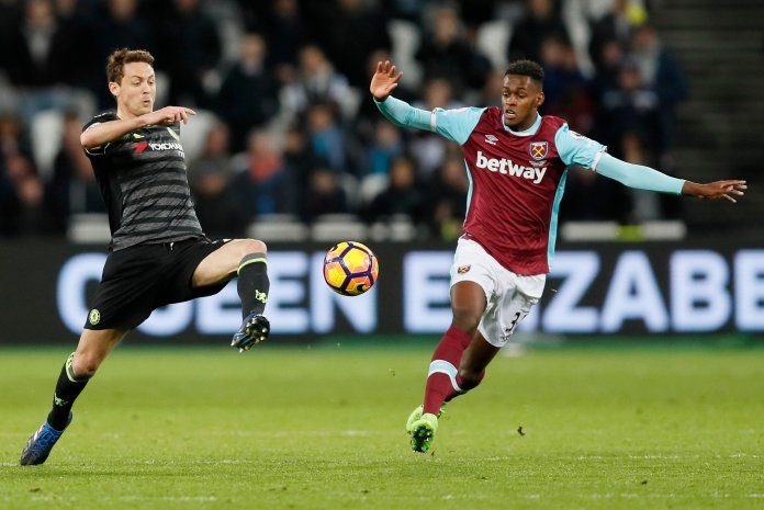 Chelsea's Nemanja Matic, left, kicks at the ball as West Ham's Edimilson Fernandes watches during the English Premier League soccer match between West Ham and Chelsea at London Stadium, Monday, March 6, 2017. (AP Photo/Kirsty Wigglesworth)