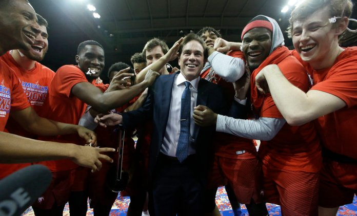 SMU head coach Tim Jankovich, center, celebrates winning the American Athletic conference with his players after an NCAA college basketball against Memphis Saturday, March 4, 2017, in Dallas.SMU won 103-62. (LM Otero/AP)