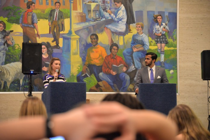 Ven Gopal and Lysette Johnson debate over who would be the best VP in the North Lobby of the Union on on Feb. 23, 2017. (Amar Batra/The Daily Campus)