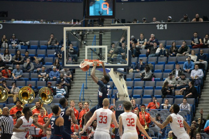 Amida Brimah slams home a dunk in UConn's 74-65 win over Houston in the second round of the American Athletic Conference tournament on Friday, March 10, 2017 at the XL Center in Hartford. (Amar Batra/The Daily Campus)