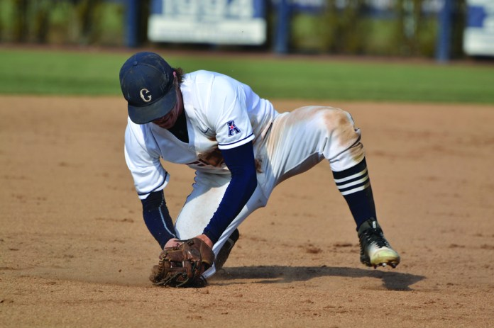 Willy Yahn fields a grounder during UConn's 8-2 victory over Yale at J.O. Christian Field on Tuesday March 8, 2016.(Rebecca Newman/The Daily Campus)