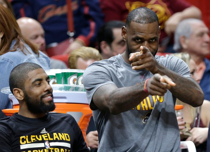 Cleveland Cavaliers'LeBron James, right, gestures as he sits with Kyrie Irving, left, on the bench during the first half of an NBA basketball game against the Miami Heat, Saturday, March 4, 2017, in Miami. (Lynne Sladky/AP)