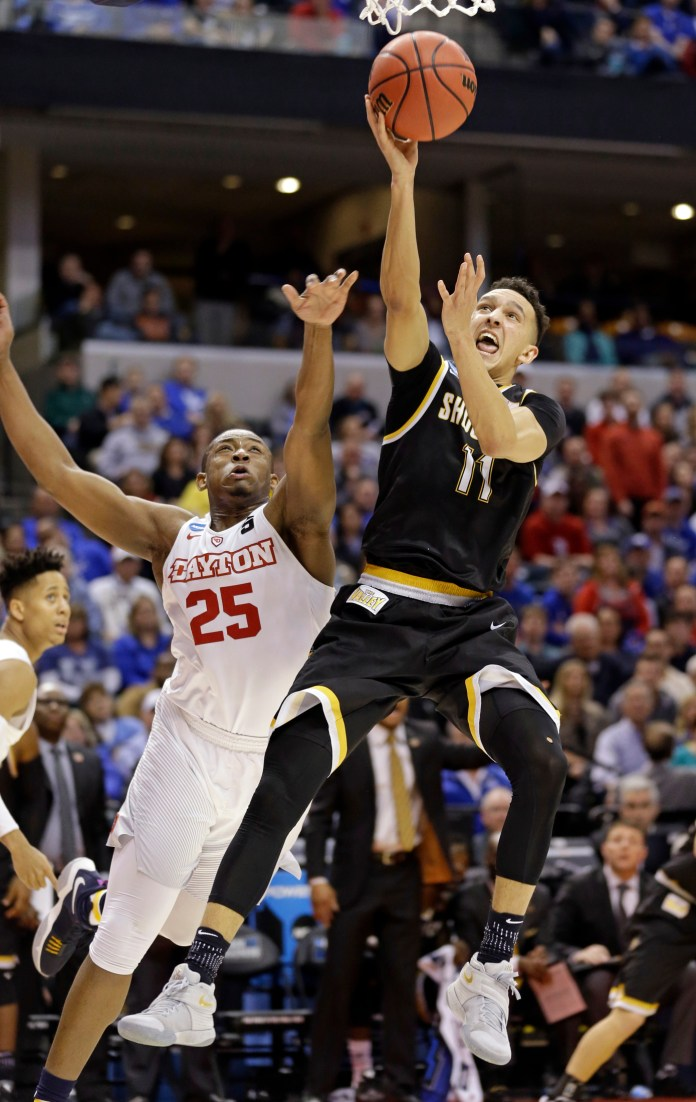 Wichita State guard Landry Shamet (11) shoots in front of Dayton forward Kendall Pollard (25) during the second half of a first-round game in the men's NCAA college basketball tournament in Indianapolis, Friday, March 17, 2017. Wichita State defeated Dayton 64-58. (Michael Conroy/AP)