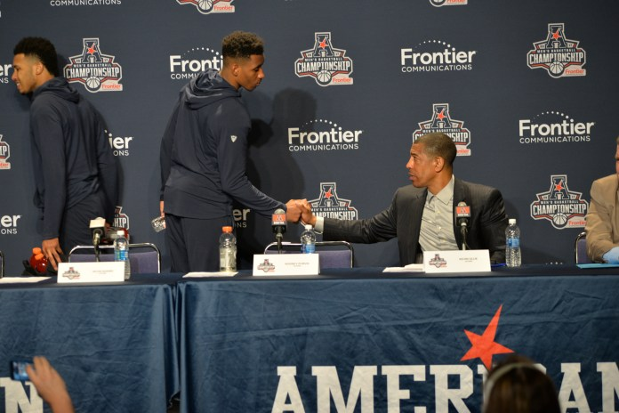 Freshman guard Christian Vital and Coach Kevin Ollie shake hands following the Huskies 81-71 loss to the Cincinnati Bearcats on in the semifinals of the American Athletic Conference championship on Saturday, March 11, 2017. (Amar Batra/The Daily Campus)