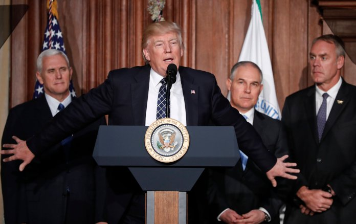 President Donald Trump, accompanied by from left, Vice President Mike Pence, Environmental Protection Agency (EPA) Administrator Scott Pruitt, and Interior Secretary Ryan Zinke, speaks at EPA headquarters in Washington, Tuesday, March 28, 2017, prior to signing an Energy Independence Executive Order.Trump signed an executive order aimed at moving forward on his campaign pledge to unravel former President Barack Obama's plan to curb global warming. (AP/Pablo Martinez Monsivais)