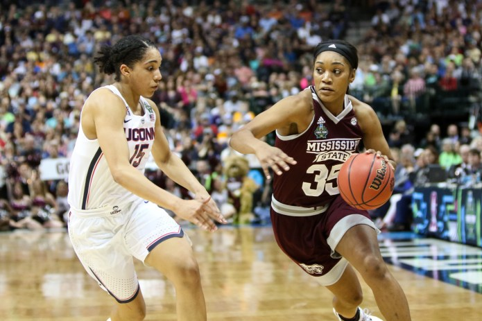 Mississippi State forward Victoria Vivians drives to the hoop against UConn forward Gabby Williams. Vivians scored 19 points to lead the Bulldogs.