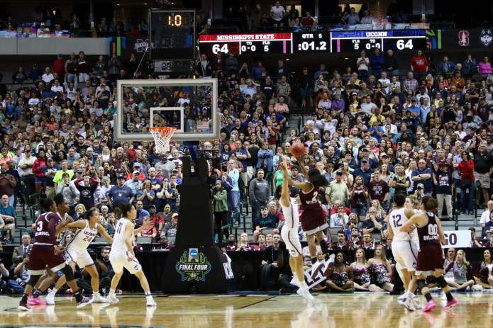 Mississippi State guard Morgan William launches a jumper over UConn's Gabby Williams with 1 second remaining in overtime. The basket won the game 66-64 for the Bulldogs, ending UConn's record 111-game winning streak.