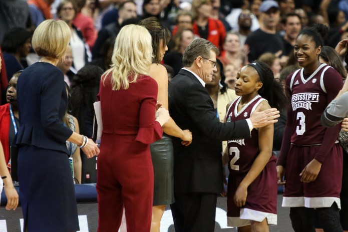 UConn head coach Geno Auriemma congratulates Mississippi State's Morgan William on her game-winning jumper. The Bulldogs advanced to the NCAA Championship final and will play South Carolina on Sunday night.