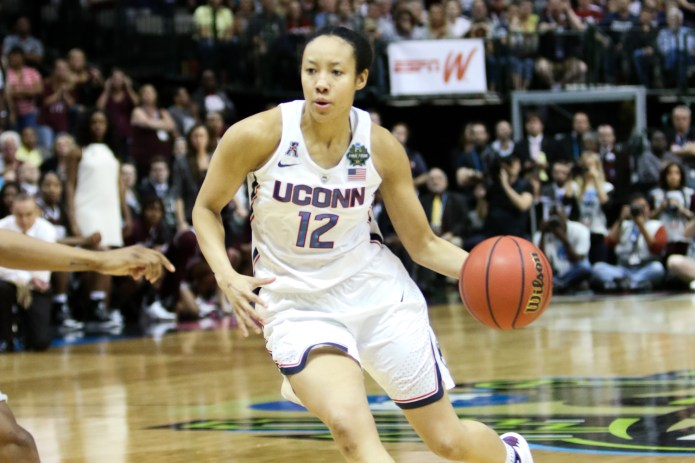 UConn senior guard Saniya Chong drives to the hoop with 14 seconds remaining in overtime. Chong turned the ball over, allowing Mississippi State to win the game on their final possession as time expired. (Jackson Haigis/The Daily Campus)