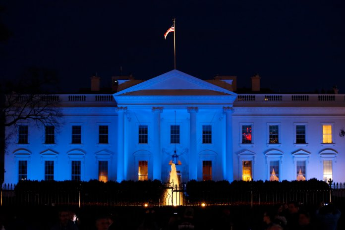 The White House is lit with blue lights in honor of World Autism Awareness Day, Sunday, April 2, 2017, in Washington. On World Autism Awareness Day, we highlight the importance of addressing the causes and improving the treatments for autism spectrum disorders (ASDs), President Donald Trump said in a presidential proclamation. (AP Photo/Alex Brandon)