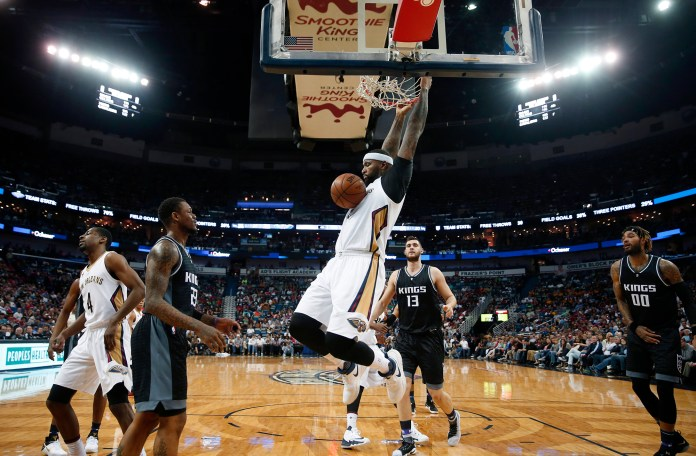 New Orleans Pelicans forward DeMarcus Cousins (0) slam dunks over Sacramento Kings guard Ben McLemore (23) center Georgios Papagiannis (13) and center Willie Cauley-Stein (00) in the second half of an NBA basketball game in New Orleans, Friday, March 31, 2017. (Gerald Herbert/AP)