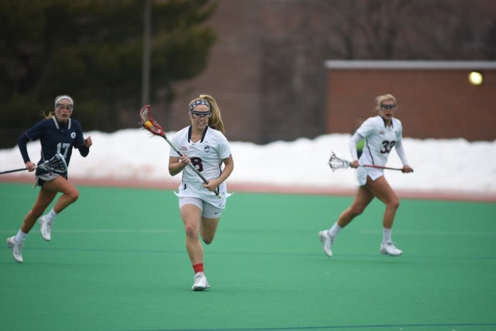 UConn junior Kelsey Catalano brings the ball up in a March 25th game against Georgetown at the Sherman Family Sports Complex. (Charlotte Lao/The Daily Campus)