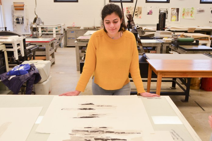 Diana Abouchacra is a fifth year senior printmaking major who will be featured in the 2017 BFA Art Show on Thursday, April 13 from 6 to 8 p.m. at the ArtSpace Gallery in Willimantic. (Akshara Thejaswi/The Daily Campus)
