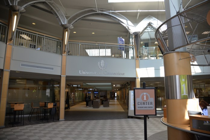 """Wilbur Cross is the administrative hub of campus and contains many student services including the Offices of the Registrar, Bursar and the office of financial aide office.Students who want to reschedule their """"bunched"""" finals can head to the iCenter at Wilbur Cross. (Amar Batra/The Daily Campus)"""