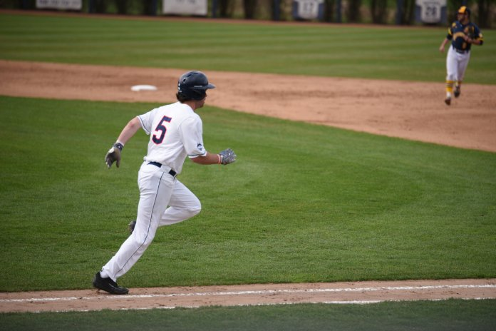 Monday's hero Jack Lambrecht runs up the line during UConn's walk off win over Quinnipiac, 4-3. (Zhelun Lang/The Daily Campus)