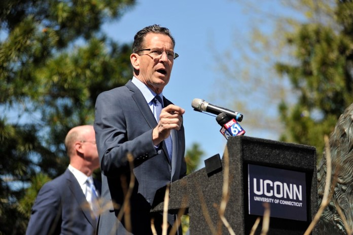 Governor Dannel Malloy visited UConn's Gampel Pavilion on Tuesday to unveil the arena's new energy-saving LED lighting system. The lighting system was made possible by collaboration with Eversource.(Jason Jiang/The Daily Campus)