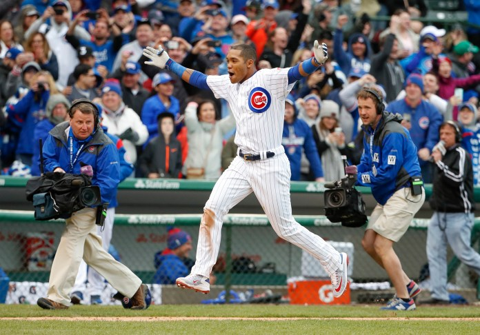 Chicago Cubs' Addison Russell celebrates as he runs down the third base line after hitting a game winning three-run home run off Milwaukee Brewers relief pitcher Neftali Feliz in the ninth inning of a baseball game, Wednesday, April 19, 2017, in Chicago. The Cubs won 7-4. (Kamil Krzaczynski/ AP)