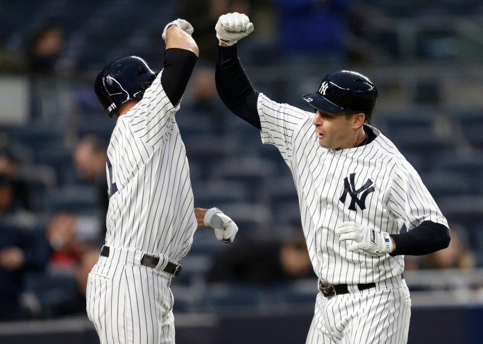 New York Yankees' Chase Headley, right, celebrates his two-run homer with Brett Gardner during the first inning of the baseball game against the Chicago White Sox at Yankee Stadium, Wednesday, April 19, 2017, in New York. (Seth Wenig/ AP)