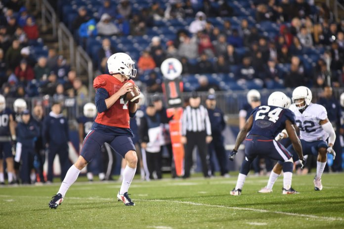 UConn quarterback Bryant Shirreffs drops back to pass during UConn football's 2017 spring game Friday night at Rentschler Field in East Hartford. (Charlotte Lao, Staff Photographer/The Daily Campus)