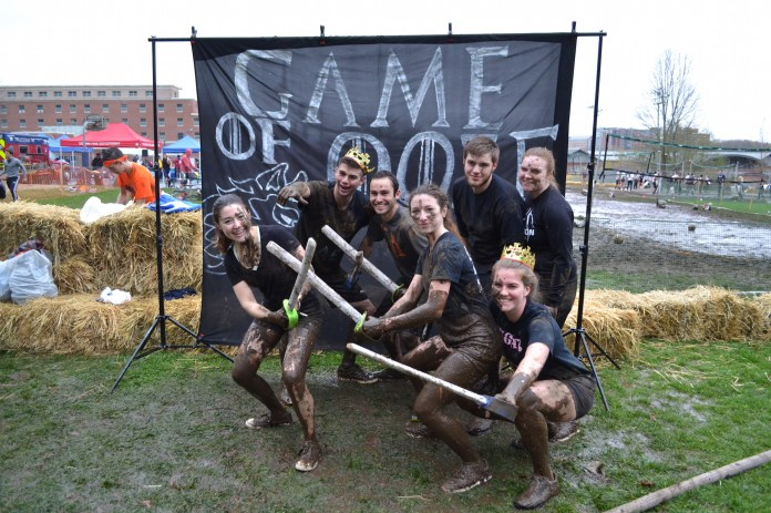 Despite the rain, students participated in the UConn tradition of Oozeball on Saturday, April 22. The volleyball tournament is a student favorite activity during spring weekend. (Olivia Stenger/The Daily Campus)