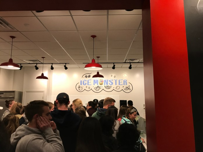 Students that had eagerly awaited the opening of Ice Monster stood in line for over an hour in a packed room. (Francesca Colturi/The Daily Campus)