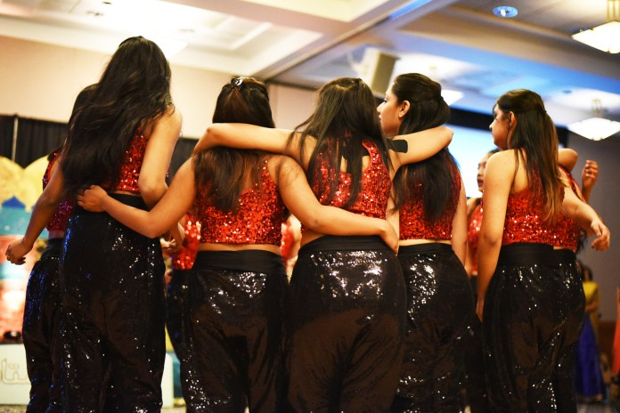 The team huddles before their performance in the PCUC Culture Showcase in Rome Ballroom.