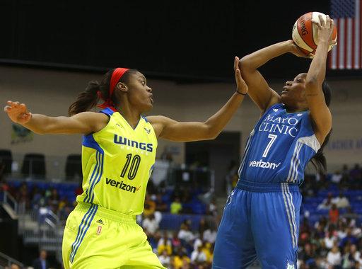 Minnesota Lynx guard Jia Perkins (7) lays up a shot against Dallas Wings guard Kaela Davis (10) in the third quarter of a WNBA basketball game in Arlington, Texas, Saturday, May 20, 2017. (Rose Baca/AP)