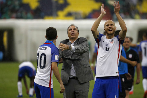 United States coach Bruce Arena, center, celebrates with Christian Pulisic, left, as Michael Bradley salutes supporters after a 1-1 draw in a World Cup qualifying match at Azteca Stadium in Mexico City Sunday.(Eduardo Verdugo/AP)