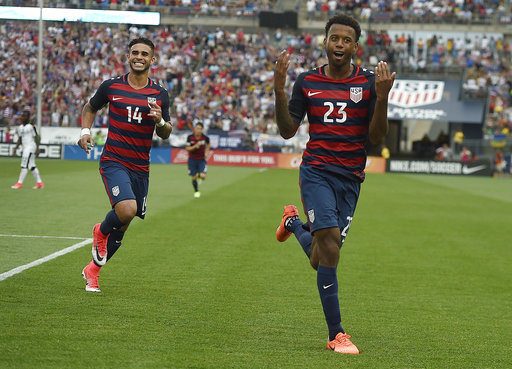 United States' Kellyn Acosta celebrates his goal against Ghana as teammate United States'Dom Dwyer smiles behind him during an international friendly soccer match at Pratt & Whitney Stadium at Rentschler Field, Saturday, July 1, 2017, in East Hartford, Conn. The USA won 2-1. (Jessica Hill/AP)